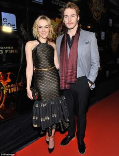 Sam Claflin and Jena Malone from Catching Fire