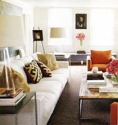 Love all the texture, the lamps, and the orange chairs.