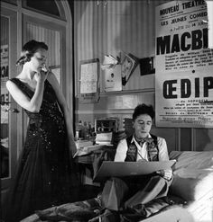 -        Jean Cocteau sketching model Elizabeth Gibbons in a Chanel dress in his hotel bedroom (Castille in the Rue Cambon)  1937.  –photo by Roger Schall