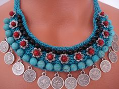This crochet necklace is totally handmade. The lenght of the necklace43cm.(16.92 inches) Materials:Turquoise,Coral and Onyx Natural Stones.Silver