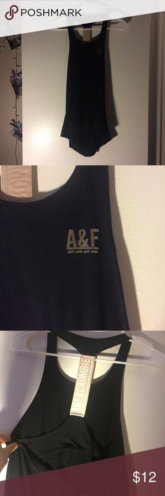 Workout tank top from Abercrombie and Fitch Abercrombie and Fitch work out top size small. Worn once. Back is adorable with a strap down the middle and a key hole right under a bra (no bra built in) pictures don't do it justice Abercrombie & Fitch Tops Tank Tops