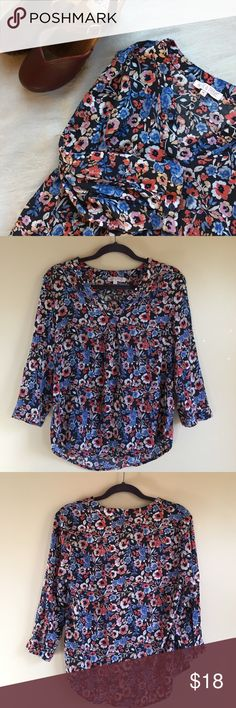 Floral 3/4 sleeve blouse Beautiful 3/4 sleeve blouse in a floral that is as perfect for Spring as it is for Fall! 23 inch total length. Rayon. Light and comfortable feels like super soft cotton. Worn once. Tops Blouses