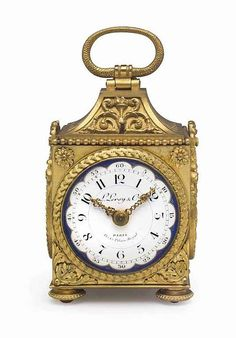 A Fine and Rare Gilt-Brass and Enamel Striking and Repeating Eight Day Miniature Pendule d' Officier Carriage Clock.  Mid 19th century.  PALAIS ROYAL, PARIS  Height 14 cm including handle.