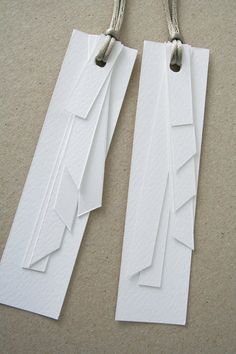 White geometric layered paper gift tags. You could also use these as earings.