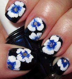 White & blue one-stroke flowers with gold glitter in the center - nail art