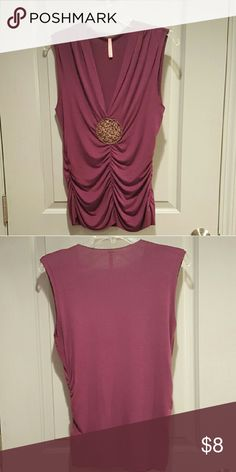 """Eight Sixty Vneck Top Sleeveless knit tank by Eight Sixty in a rich plum color. Deep vneckline with an embroidered medalion detail at the end of the drop. Ruching on the sides help define waistline. Raw edges along the seams add a bit of edginess. Runs very fitted through the body.  No stains, holes, fading, or major piling. Fabric does show signs of wear/wash when examining closely. Still in good condition.  93% modal, 7% spandex. Hand wash recommended.  Approx. 26"""" length, 16"""" across bust…"""