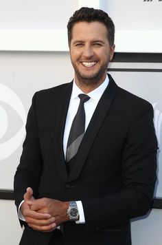 Luke Bryan Photos Photos - Recording artist Luke Bryan arrives for the 52nd Academy of Country Music Awards on April 2, 2017, at the T-Mobile Arena in Las Vegas, Nevada. / AFP PHOTO / Tommaso Boddi - 52nd Academy of Country Music Awards - Arrivals