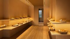 Design studio I IN has used warm, golden hues to decorate the Pinocchio bakery in Yokohama, Japan, which displays bread and pastries on minimalist shelves. Bakery Interior, Retail Interior, Apartment Interior, Interior And Exterior, Interior Design, Interior Shop, Pinocchio, Yokohama, Tiny Office