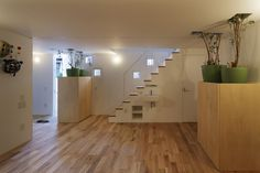 Roomroom / Takeshi Hosaka bathroom under stairs sink on the outside