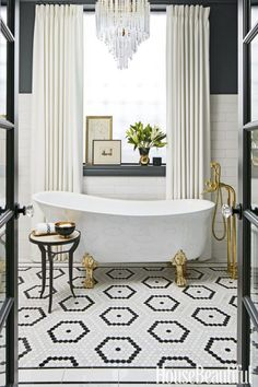 """I wanted drama!"" says designer SuzAnn Kletzien of this daring en suite bathroom. The impact begins with a dynamic hexagonal-tile ""rug"" by Artistic Tile. In Nero Marquina, Pacific White and Thassos marbles, it's a luxe version of traditional penny-tile."