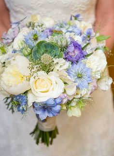 We admit that we're always swooning over succulent creations and this bouquet is no exception, created by Laughin' Gal Floral and captured by Sphynge Photography. See the wedding it belongs to here.