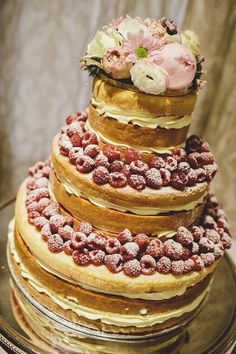 """""""Naked"""" cake adorned with sugared raspberries and loveliness. Not for a wedding, though, but perhaps a shower."""