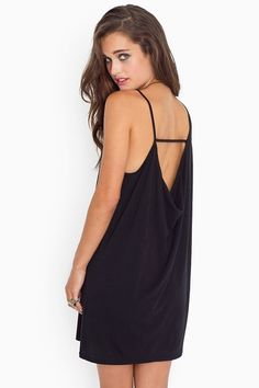 Black dress, asymmetric straps and a draped cutout back. By Cheap Monday.