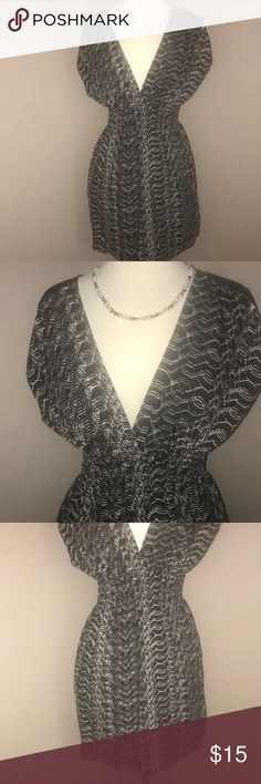 EUC GUESS PATTERN MINI DRESS w/ ZIPPER SHOULDER STUNNING MINI DRESS BY GUESS . Great silky material with black and white pattern throughout. LOVE THE BKACK AND COPPER ZIPPERS ON THE SHOULDERS. Dress has bat like shirt sleeves. ELASTIC WAIST BAND. And my favorite a deep v neckline Guess Dresses Mini