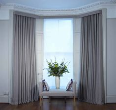 Wrought iron pole: The most cost effective way to hang curtains on a bay window.