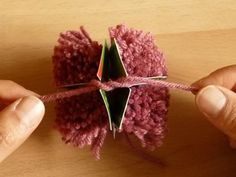 My mom taught me how to make pom poms like this when I was a kid.