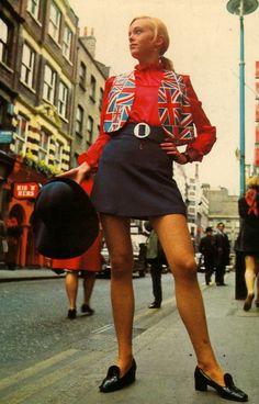 1960's fashion shoot, London. Girl in mini skirt & Union Jack waistcoat.