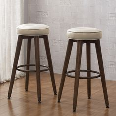 Perfect for completing your bar area or kitchen island, these retro bar stools feature a cream tufted and upholstered seat. Footrests and non-mar foot glides complement the classic style of these stools.