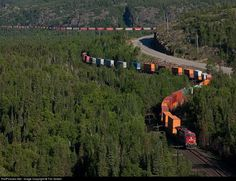 RailPictures.Net Photo: CP 8781 Canadian Pacific Railway GE ES44AC at Neys, Ontario, Canada by Tim Gobeil. One of CP's monster 12000 f.t 110's grinds its way up the ruling Heron Bay sub grade at Neys and the train can be seen over 2 miles away along the steep rock bluffs overlooking Lake Superior.