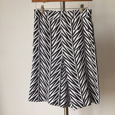 DVF Diane Von Furstenberg A Line geometric skirt Love this Diane Von Furstenberg skirt.  Zip closure.  Knit fabric.  Marked a 6, fits more like a 2 or small 4.  There is some wear to the fabric, it is pre loved.  This is reflected in the price. Diane von Furstenberg Skirts A-Line or Full