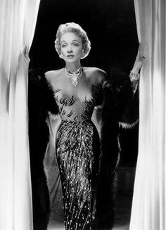 - Marlene Dietrich - Although she loved menswear, Marlene didn't wear suits 24/7 - she also had a fondness for all things luxe. She wore pencil skirts, form-fitting dresses and silky blouses for a sultry look that exuded Old Hollywood glamour. -