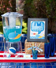 Creative Pool Party {or Playdate} Ideas for Little Swimmers - Love the beach balls inside the beverage dispenser! Such a cute way to continue a party theme through the food table!