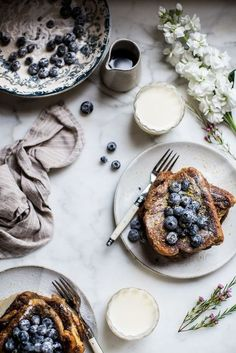 Fluffy London Fog French toast and sugar blueberries. This recipe is a clear twist on everyone's breakfast favourite. The French toast is flavoured with earl grey and a lavender scent to give an unusual but tasty adaptation. They are then topped with blueberries coated in sugar and best eaten served warm and fresh. Is it breakfast? Is it dessert? We don't care because we'll eat it for both.