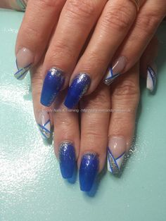 Electric blue gel polish with freehand nail art