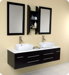 Art Belle Espresso Modern Double Vessel Sink Bathroom Vanity http://www.listvanities.com/contemporary-bathroom-vanities.html is our most popular vanity from the Belle line. Marble, real wood and ceramic make up this stunning piece usually installed in high end residences. Double sinks make this perfect for a master bedroom, his and hers with equal amount of drawer space.