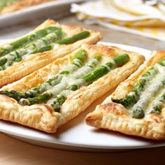 Looking to impress your guests? Try these delicious tarts that are really easy to prepare. Spread Dijon-style mustard on strips of puff pastry and top with fresh asparagus and shredded Gruyère cheese. 20 minutes in the oven and you've got amazing tarts that are simply irresistible. Try them for brunch or at your next dinner party …