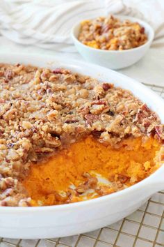 With a rich and creamy sweet potato base and a crunchy, buttery pecan streusel topping, this salty-sweet Sweet Potato Soufflé is a decadent show-stopper that& have your Thanksgiving table swooning for more. Sweet Potato Souffle, Sweet Potato Pecan, Sweet Potato Casserole, Casserole Dishes, Moist Cornbread, Perfect Mashed Potatoes, Souffle Recipes, Sweet And Salty, Baking Recipes