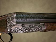 I like how the engraving continues onto the barrel.