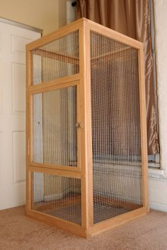 Here's a tall wood and wire flying squirrel cage.