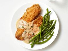 When making Chicken-Fried Fish, dredge tilapia in a flour and paprika mixture before frying until golden. Top with a creamy sauce and serve with green beans.