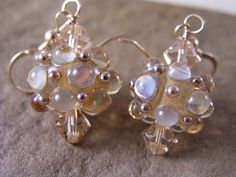 Gold Opalescent Lampwork Earrings made by Jennifer Lynn Studio created with handtorched lampwork beads made by Eric Larson of Enchanted Dreams Jewelry.