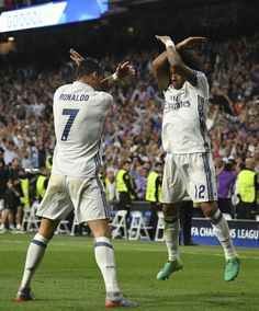 Ronaldo and Marcelo celebrate the Portugese star's goal