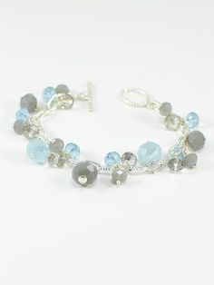 Bracelet 1565 - Add a little sparkle to your day with this modern silver chain bracelet featuring a rich mix of opal grey and alexandrite faceted rondelle beads.Alexandrite appears periwinkle blue in flourescent light, and lilac in natural light.