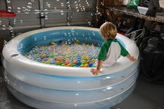 Pool in the garage with ball pit, water and bubbles???? Why didn't I think of that?