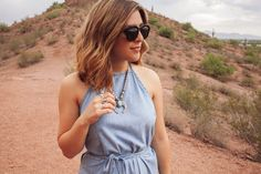 {The Denim Wrap Dress   Simply Audree Kate} Light denim halter wrap dress outfit styled with a chunky silver necklace and black sunglasses