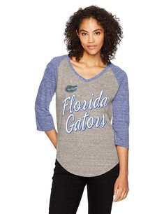 1ffe8d7a5 OTS NCAA Adult Women s Triblend Raglan Distressed Tee The OTS Triblend  Raglan Tee Distressed is made of a sophisticated sporty material that makes  this top ...