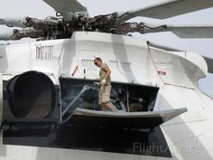 Look how large a Russian Mil Mi26 helicopter is. An easy comparison with crew member standing on door during maintenance.