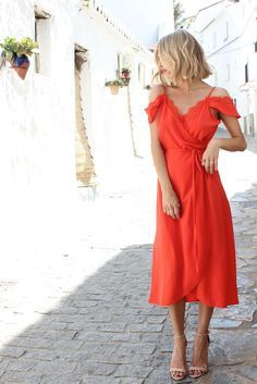 A cute dress for a vacation in Greece or Italy. Perfect for sunset drinks!