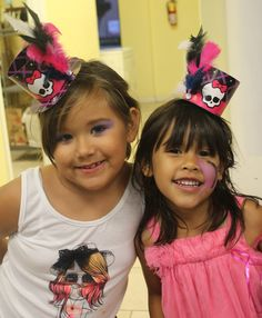 Monster High Birthday Party Top Hats - Embellished with feathers and a jewel. Easy to do and makes them even more adorable!