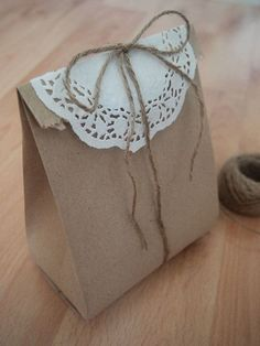 Recycled Brown Paper Bags  with a doily topper and jute twine