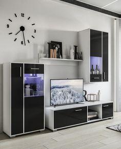 Черная стенка в гостиной в современном стиле с тумбой для телевизора и настенными часами