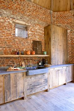 Who says a kitchen has to be cold and clinical? With elements of rough wood, stone, concrete, and brick, these kitchens exude an irresistible rustic warmth. Rustic Kitchen, New Kitchen, Kitchen Dining, Kitchen Ideas, Kitchen Decor, Kitchen Shelves, Open Shelves, Exposed Brick, Home Kitchens