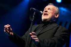 FILE - In this July 20, 2002 file photo, British Rock and Blues legend Joe Cocker performs on stage of the Stravinski hall during the Montreux Jazz Festival, in Montreux, Switzerland.  ▼30Dec2014AP|Joe Cocker dies at 70 http://bigstory.ap.org/article/79d1bef5fc54495d8da01adfa38f893b #Joe_Cocker