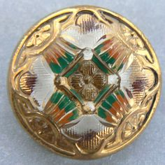 Reverse painted gold luster embellished glass button.