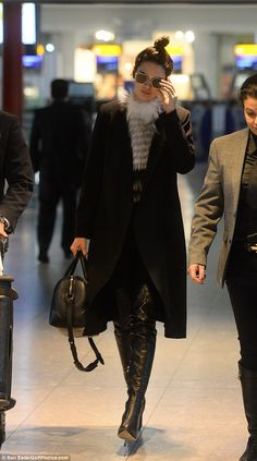 Leather lady: Her sky high boots added a super-sexy edge to the jet set look