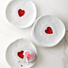 Soft, organic shapes and bright red heart designs give our creamy white plates the homespun charm of handmade paper valentines. The sturdy stoneware pieces provide endearing presentation for all sorts of festive foods, from breakfast pastries to d… Clay Art Projects, Clay Crafts, Keramik Design, Appetizer Plates, Dessert Plates, Party Appetizers, Party Plates, Pottery Painting Designs, Valentine's Day